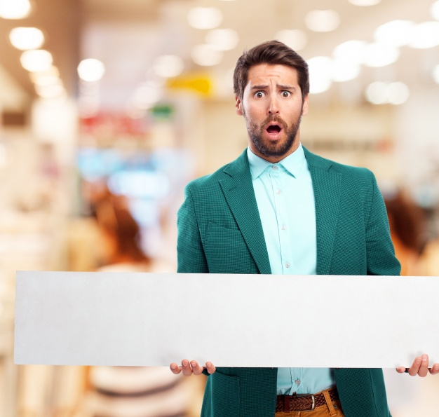 Man in a shopping center with a poster  Photo |  Download