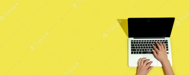 Photo | Hand using gadgets, laptop on top view, blank screen with copyspace, minimalistic style. technologies, modern, marketing. negative space for ad, flyer. yellow color on background. stylish, trendy.