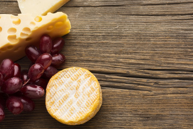 Top view gourmet cheese and grapes with copy space |  Photo