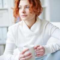Pensive woman with a white sweater  Photo |  Download