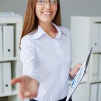 Smiling secretary with glasses and white shirt  Photo |  Download